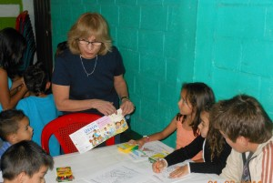 Norma Hull shares the gospel with children.